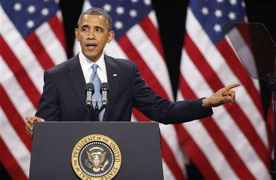 President Barack Obama speaks about immigration reform Tuesday, Jan. 29, 2013, at Del Sol High School in Las Vegas. (AP Photo/Isaac Brekken) Photo: AP / FR159466 AP