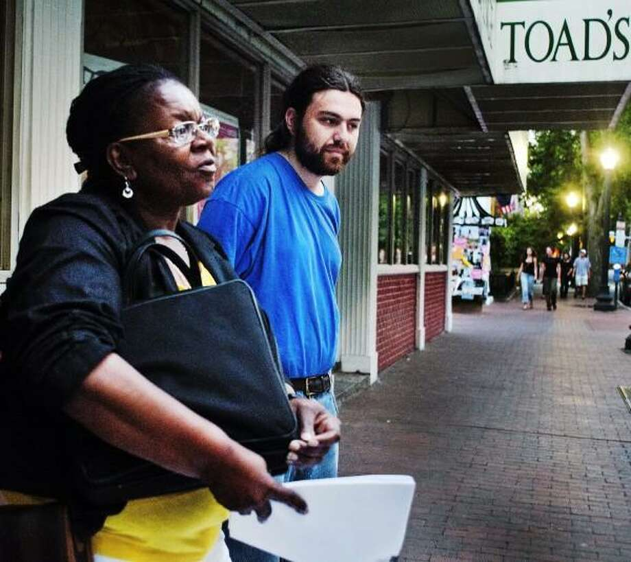 Barbara Fair (L) and Greg Williams stand outside of Toad's Place 7/31 where they had hoped to present  owner/manager, Brian Phelps with  petitions concerningTed Nugent's upcoming show. Melanie Stengel/New Haven Register