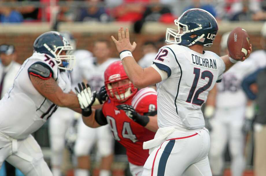 UConn's Casey Cochran (12) passes against SMU. Photo: Ricky Moon  — The Dallas Morning News/The Associated Press   / The Dallas Morning News