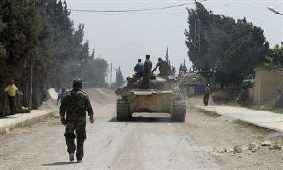 Forces of Syrian President Bashar al-Assad are seen in Arjoun village near Qusair town May 30.