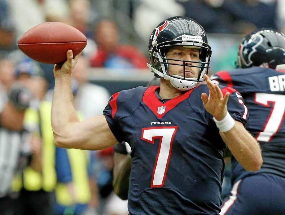 Houston Texans quarterback Case Keenum passes during the first quarter against the Jacksonville Jaguars. Photo: Patric Schneider — The Associated Press   / FR170473