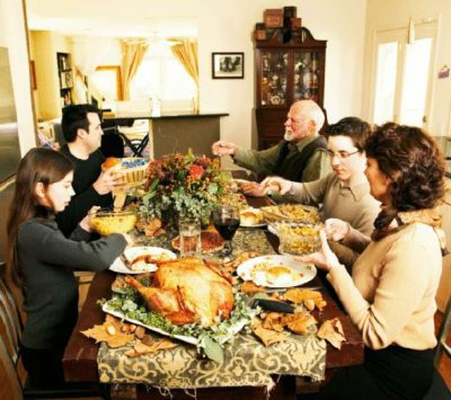 A family sits down for Thanksgiving. In case Obamacare gets brought up, here's your talking point guide. Photo: Www.jupiterimages.com / (C) 2005 Hollingsworth Studios 2