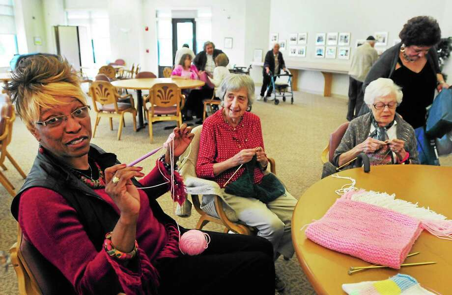 (Photo by Peter Hvizdak — Register)Bettye Morrison, left, Miriam Belski, center,  and  Mae Berkman,Tower One residents,  knit for the mothers and children at Life Haven in New Haven Thursday September 26, 2013. At far right is Vivian Kantrow, Tower One director of development and community relations. Photo: New Haven Register / ©Peter Hvizdak /  New Haven Register