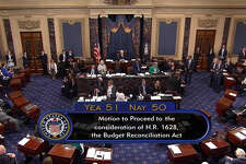In this image from video provided by C-SPAN2, the final Senate vote, with Vice President Mike Pence's vote, to start debate to tear down much of the Obama health care law, Tuesday, July 25, 2017, on the floor of the Senate on Capitol Hill in Washington.  (C-SPAN2 via AP)