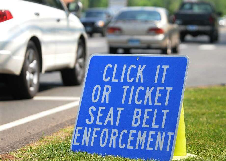 Catherine Avalone/The Middletown PressMiddletown Police Department were set up on Newfield Street for the Click It or Ticket Seat Belt Enforcement campaign Friday afternoon. Police across the state have increased their efforts enforcing the seat belt law that began May 20 and ends on June 2. The penalty for the ticket is $92. / TheMiddletownPress