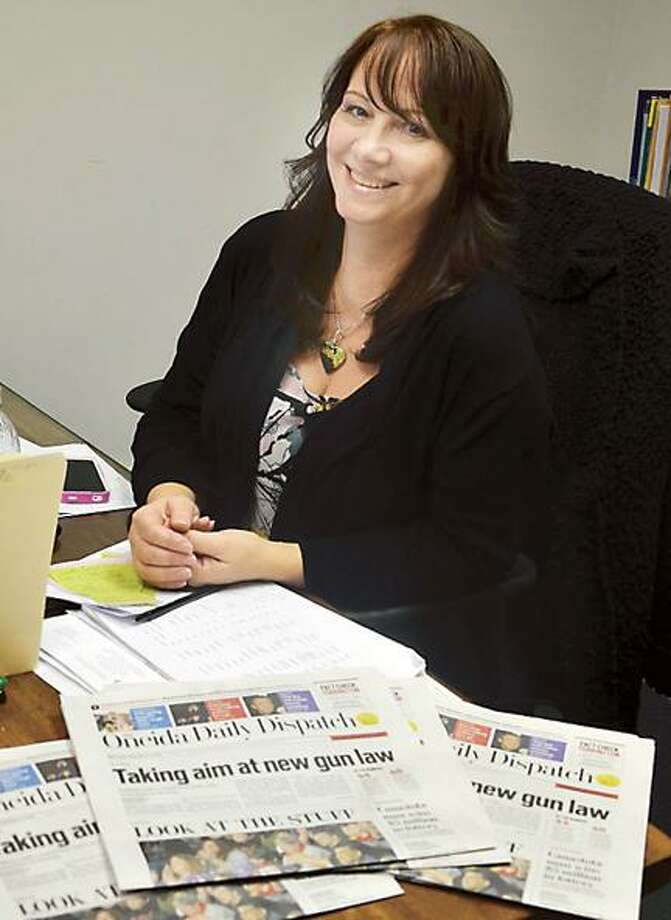 Dispatch Staff Photo by KURT WANFRIED A test printing of the redesigned Oneida Daily Dispatch is spread out on the desk of Karen Alvord, general manager and advertising director.