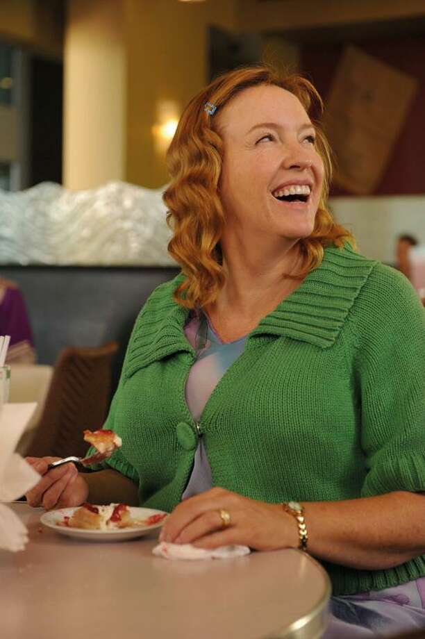 """Universal Pictures photo: Toni Collette plays a loopy housekeeper to a distracted family in """"Mental,"""" now playing at BowTie Criterion Cinemas."""