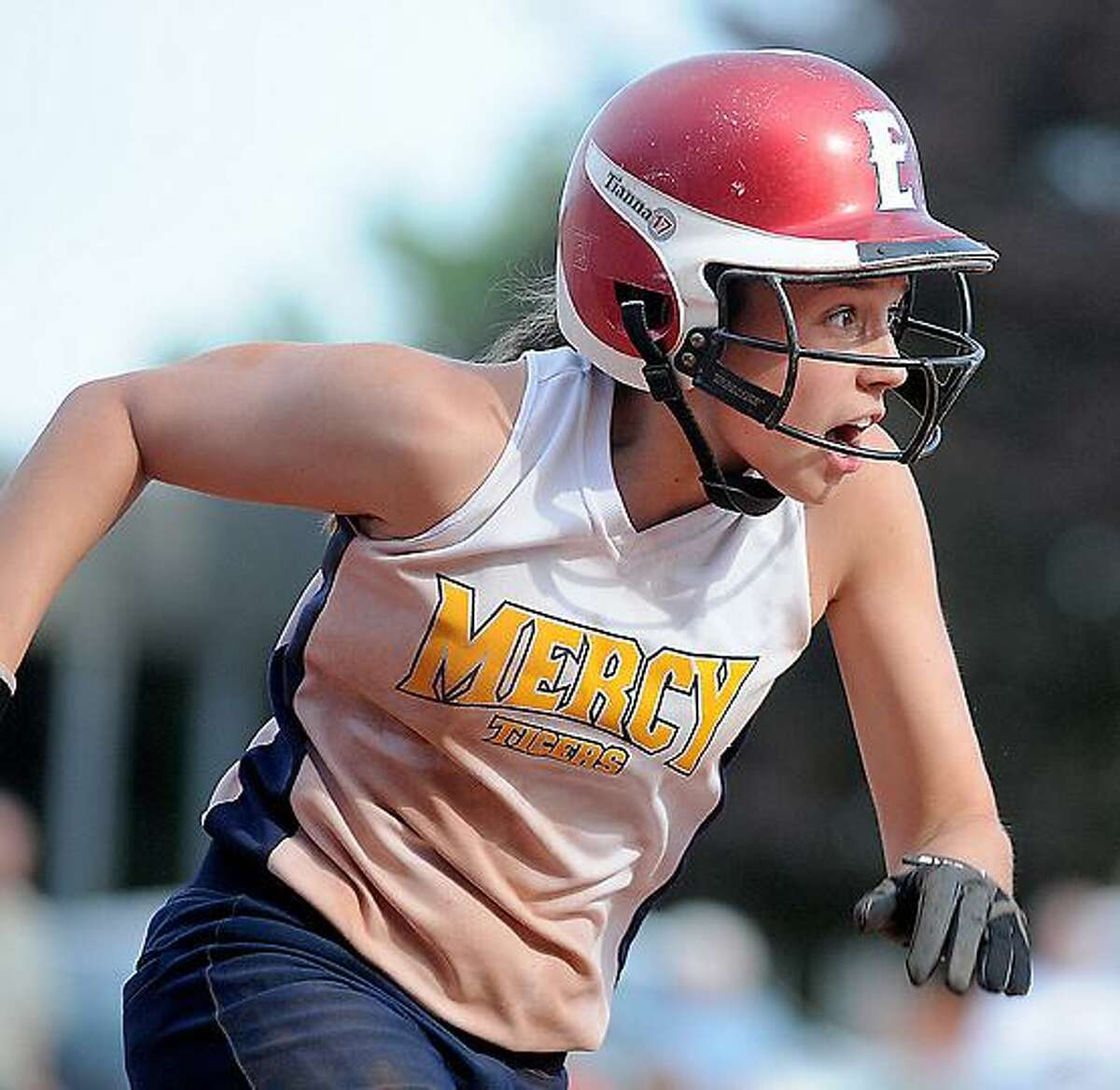 Catherine Avalone/Middletown Press It's upwards and onwards for Madison DeRita (pictured) and Mercy softball, which advanced to the Class LL state tournament semifinals with a nine-inning win against Hand Friday.