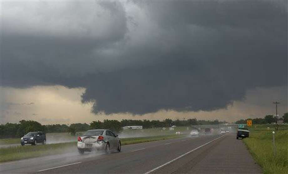 A wall cloud forms near Interstate 35 and Purcell, Okla. on Thursday, May 30, 2013. At least two tornadoes touched down in Oklahoma and another hit Arkansas on Thursday as a powerful storm system moved through the middle of the country. At least nine injuries were reported. (AP Photo/Alonzo Adams) Photo: AP / FR159426 AP