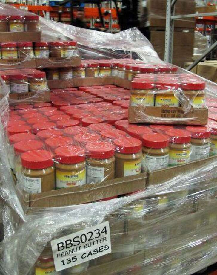 This Nov. 9, 2011, photo shows a single pallet of peanut butter at the Broad Street Presbyterian Church food pantry in Columbus, Ohio. (AP Photo/Kantele Franko) Photo: ASSOCIATED PRESS / AP2011