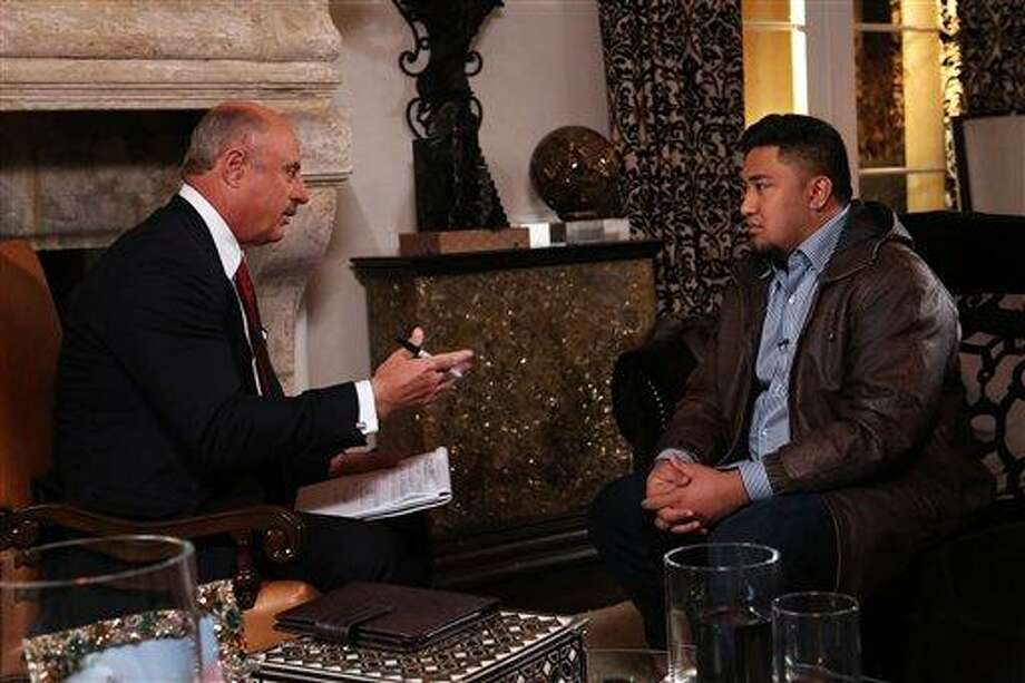 "In this Jan. 24, 2013, photo provided by CBS Television Distribution/Peteski Productions, talk show host Dr. Phil McGraw, left, interviews Ronaiah Tuiasosopo during taping for the ""Dr. Phil Show"" in Los Angeles.  The program, scheduled to air Thursday, Jan. 31, and Friday, Feb. 1, will show the first on-air interview of Tuiasosopo, the man who allegedly concocted the girlfriend hoax that ensnared Notre Dame football star Manti Te'o. (AP Photo/CBS Television Distribution/Peteski Productions) Photo: AP / CBS"