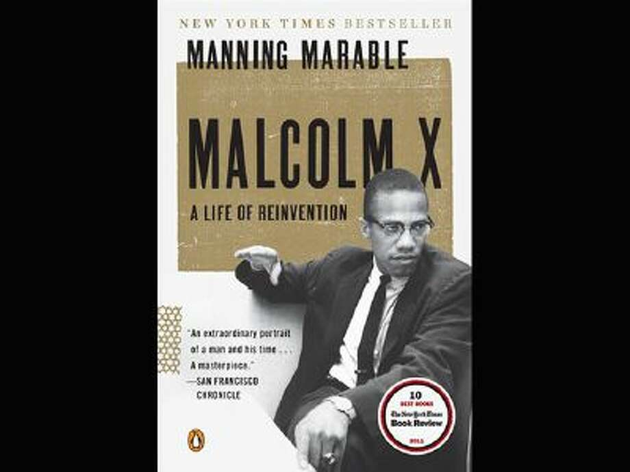 "This book cover image released by Viking shows ""Malcolm X: A Life of Reinvention"" by Manning Marable. Photo: AP / Viking"
