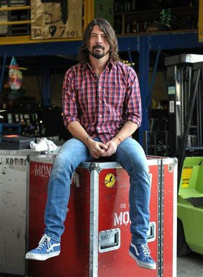 Musician Dave Grohl poses for a portrait at 606 Sound on Wednesday, Jan. 9, 2013, in Los Angeles. (Photo by John Shearer/Invision/AP) Photo: John Shearer/Invision/AP / Invision