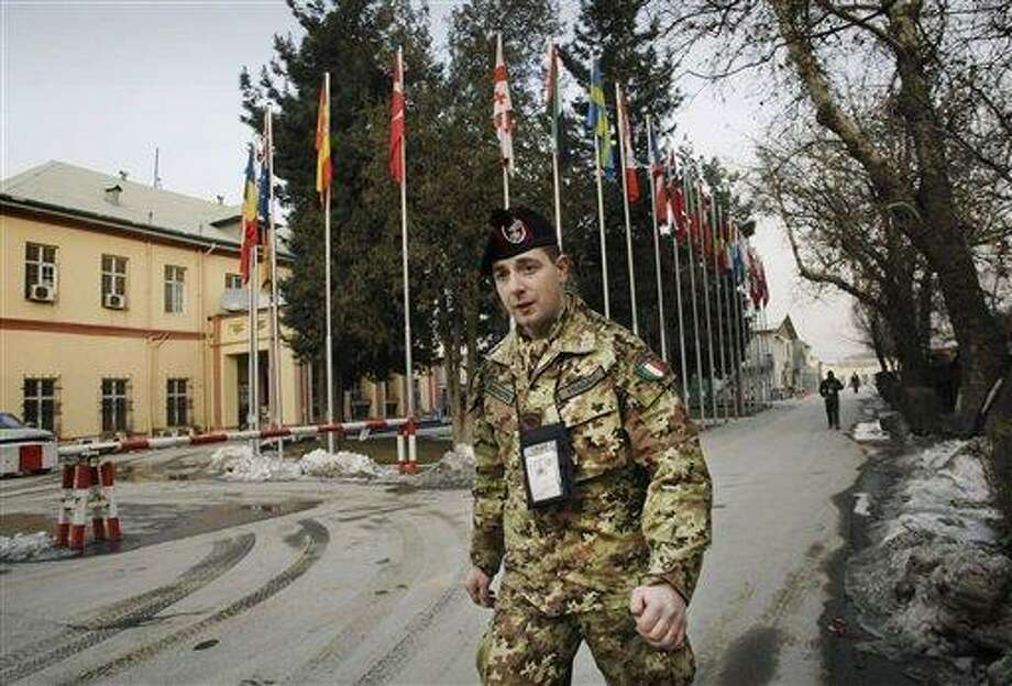 In this Sunday, Jan. 27, 2013 photo, an Italian soldier with the NATO-led International Security Assistance Force (ISAF) troops walks at the compound of NATO's head quarters in Kabul, Afghanistan. U.S. Marine Gen. John Allen, the top commander of the ISAF troops in Afghanistan, has expressed confidence that Afghan security forces will be able tackle the insurgency when they take the lead in the 11-year-old war against the Taliban this spring, and will be able to hold their own against the Taliban on the battle field without the presence of foreign troops fighting on the front line. (AP Photo/Musadeq Sadeq) Photo: AP / AP