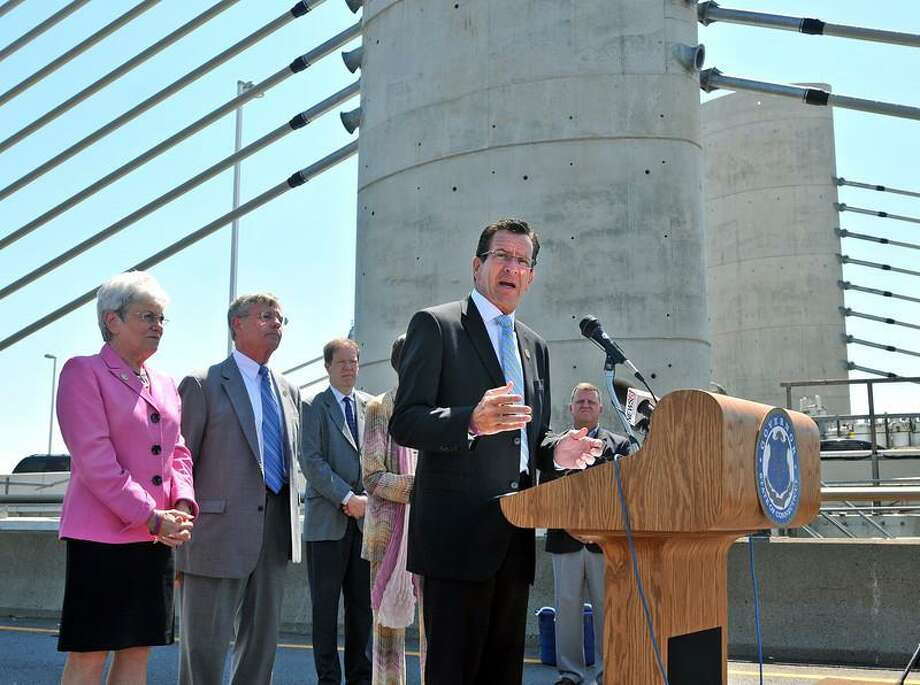 "Peter Casolino -- RegisterGovernor Dannel P. Malloy speaks during a press conference on the existing old section of the Q Bridge that is now in the process of being torn down. Malloy and other dignitaries spoke about the ""Transform CT Initiative,"" and the recent traffic shift onto the new Pearl Harbor Memorial Bridge. Both lanes of I-95 are now currently flowing over the new span.<a href=""mailto:pcasolino@newhavenregister.com"">pcasolino@newhavenregister.com</a>"