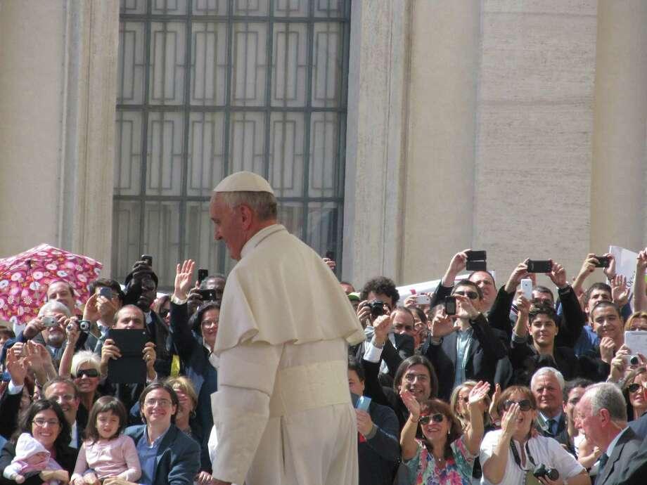 Pope Francis talks to pilgrims.