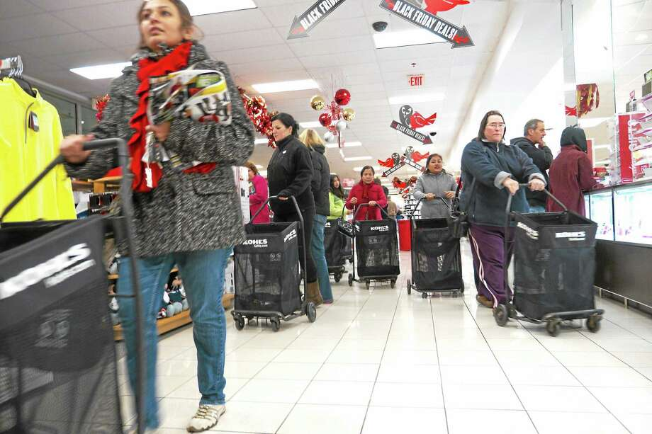 Shoppers and salespeople do their thing at Kohl's in Branford Thursday after the store opened at 8 p.m. Photo: VM Williams — New Haven Register