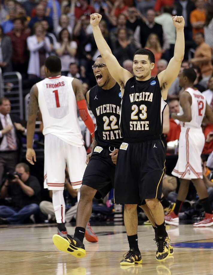 Wichita State's Carl Hall (22) and Fred Van Vleet celebrate their team's 70-66 win over Ohio State in the West Regional final in the NCAA men's college basketball tournament, Saturday, March 30, 2013, in Los Angeles. Ohio State's Deshaun Thomas (1) walks off at left. (AP Photo/Jae C. Hong) Photo: AP / AP