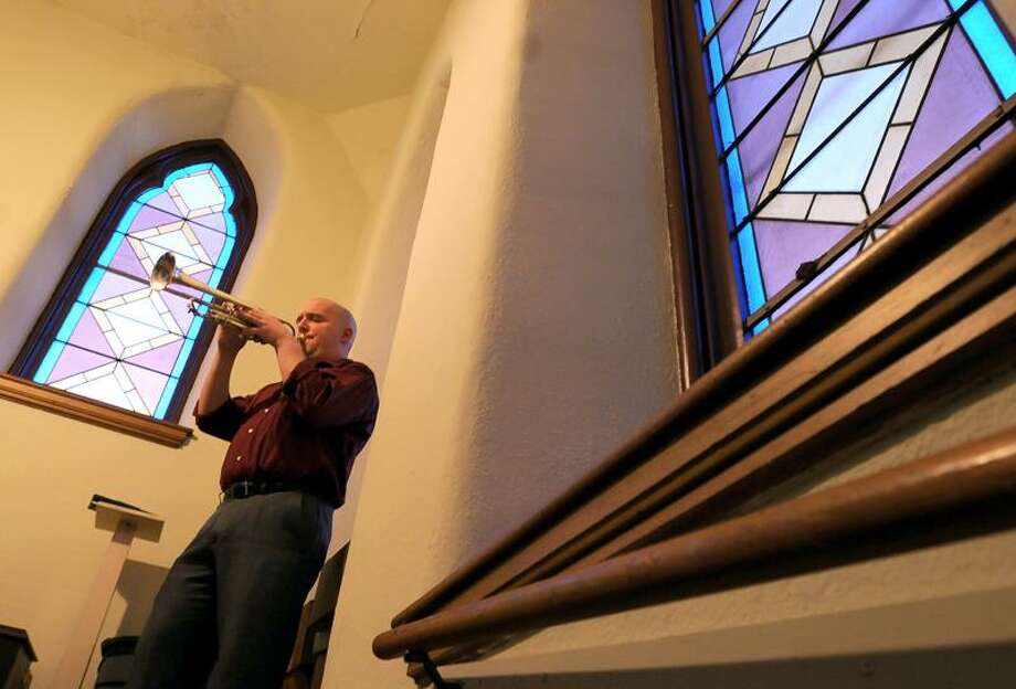 "Standing in the choir loft of St. Francis Church in New Haven, trumpeter and church member Nick Laurie of East Haven warms up before playing at the Holy Saturday Easter Vigil Mass Saturday night March 30, 2013. Among the musical selections he will be playing are ""Jesus Christ is Risen"" and Aria con Variazoni by Handel.  Photo by Peter Hvizdak / New Haven Register. Photo: New Haven Register / ©Peter Hvizdak /  New Haven Register"