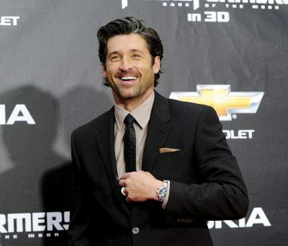 """Grey's Anatomy"" star Patrick Dempsey certainly sounds less than enthused about his role as Dr. Derek Shepherd. He'd rather be driving a race car at LeMans, as he does in the four-part series cleverly titled ""Patrick Dempsey: Racing LaMans,"" which premieres Aug. 28 on cable channel Velocity. (AP Photo/Evan Agostini) Photo: ASSOCIATED PRESS / A20112011"