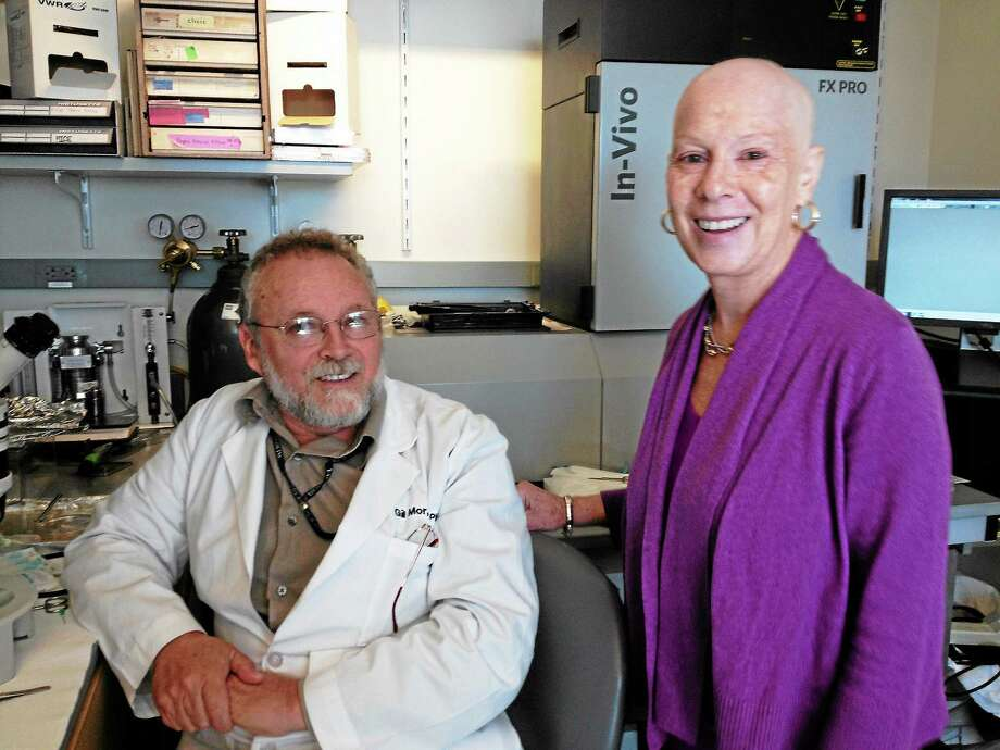 Dr. Gil Mor, an MD/Ph.D at Yale University, is a co-founder of Discovery to Cure, researching women's reproductive cancers. He shows Beverly Levy, an ovarian cancer survivor, around the lab. (Photo by Sandi Shelton/Register) Photo: Journal Register Co.