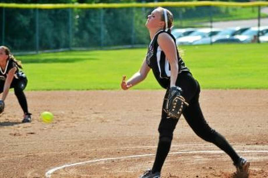 Pete Paguaga/Register Citizen Thomaston's Abby Hurlbert shut down the Canton Warriors only allowing three hits.