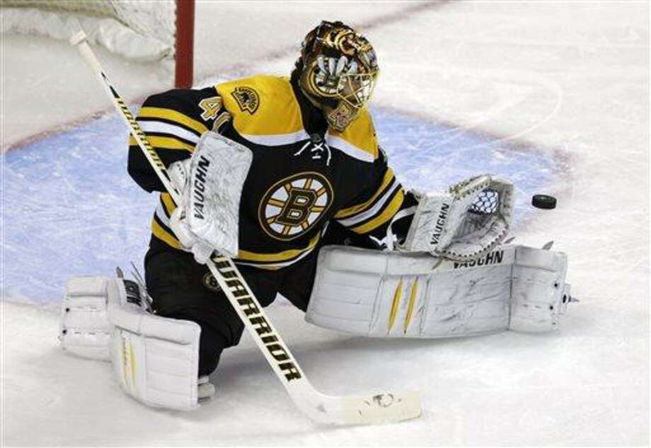 Boston Bruins goalie Tuukka Rask makes a save against the New York Rangers during the first period in Game 5 of the Eastern Conference semifinals in the NHL hockey Stanley Cup playoffs, Saturday, May 25, 2013, in Boston. (AP Photo/Charles Krupa) Photo: AP / AP