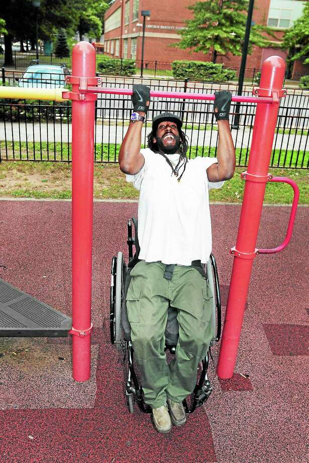 (Photo by Peter Hvizdak — Register)Yancey Horton, aka Brother Born, does pull-ups while attachéd to his wheelchair Friday evening September 27, 2013 at the Lincoln-Basset School playground in New Haven. A victim of a gunshot during a robbery, Horton was paralysed from the waist down. Photo: New Haven Register / ©Peter Hvizdak /  New Haven Register