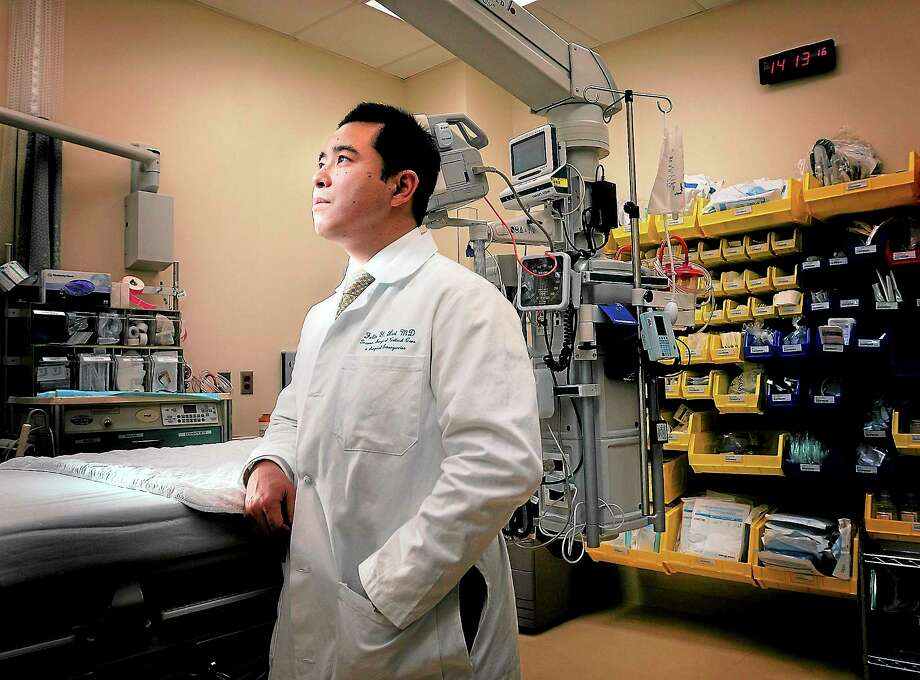 Dr. Felix Lui, a trauma surgeon at Yale-New Haven Hospital, has treated more than 100 gunshot victims in his career. Photo: Peter Casolino — New Haven Register