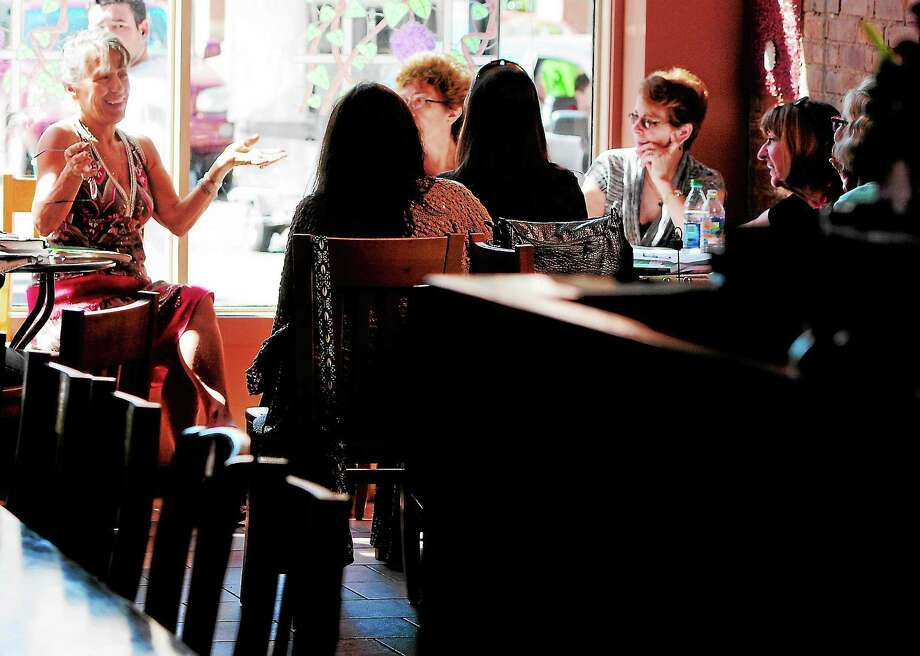 Anna Sincavage, one of the owners of Skappo Wine Bar, teaching one of her Italian language classes there. Photo: Peter Hvizdak — Register Photos   / ©Peter Hvizdak /  New Haven Register