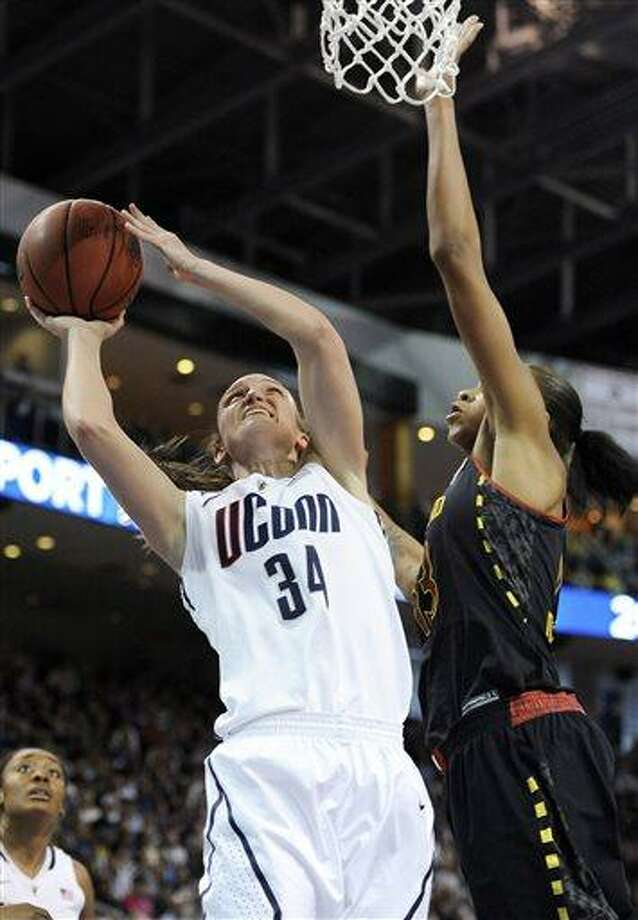 Connecticut guard Kelly Faris (34) shoots against Maryland center Alicia DeVaughn, right, during the first half of a women's NCAA college regional semifinal basketball game in Bridgeport, Conn., Saturday, March 30, 2013. (AP Photo/Jessica Hill) Photo: ASSOCIATED PRESS / AP2013