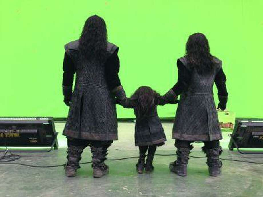 "In this Friday, July 26, 2013 photo taken and released by Peter Jackson, actor Richard Armitage, left, and two unidentified actors stand as they face with a green screen set on the final day of shooting The Hobbit in Wellington New Zealand. Jackson has wrapped up filming ""The Hobbit"" trilogy and shared pictures of his last day on the set with his Facebook fans. The New Zealand filmmaker provided a steady stream of updates and photos from the set of the final film, ""The Hobbit: There And Back Again,"" on Friday, July 26. The second film, ""The Hobbit: The Desolation of Smaug,"" will be released in December, and the finale appears in 2014. (AP Photo/Peter Jackson) Photo: AP / Peter Jackson"