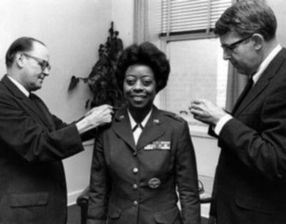 Col. Ruth Lucas is seen at a ceremony in which she was promoted to colonel in 1968. The two men in the photo are not identified. (Photo via U.A. Air Force)