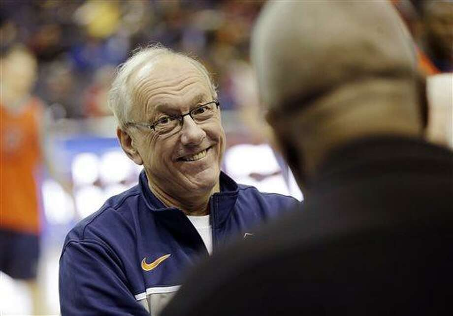 Syracuse coach Jim Boeheim, left, smiles as he talks to former Georgetown head coach John Thompson, right,  during practice for a regional semifinal game in the NCAA college basketball tournament, Wednesday, March 27, 2013, in Washington. (AP Photo/Pablo Martinez Monsivais) Photo: ASSOCIATED PRESS / AP2013