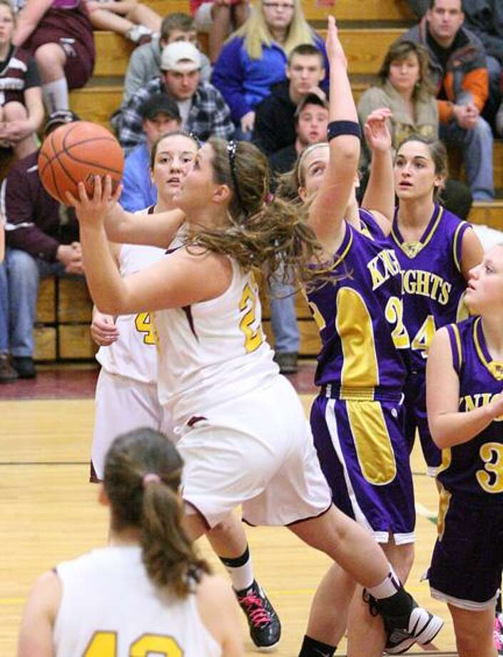 JOHN HAEGER @OneidaPhoto on Twitter/ONEIDA DAILY DISPATCH Canastota's Shea Foster (23) goes up for a shot against Holland Patent's Allyson Freiermuth (22).