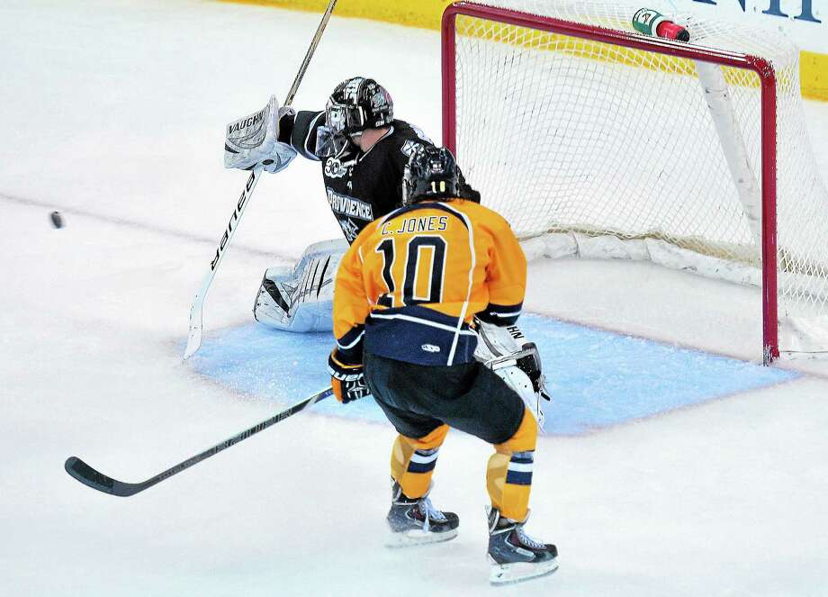 Connor Jones and Quinnipiac skated to a 3-3 tie with goalie Jon Gillies and Providence on Wednesday night at High Point Solutions Arena in Hamden. Photo: Peter Casolino — Register