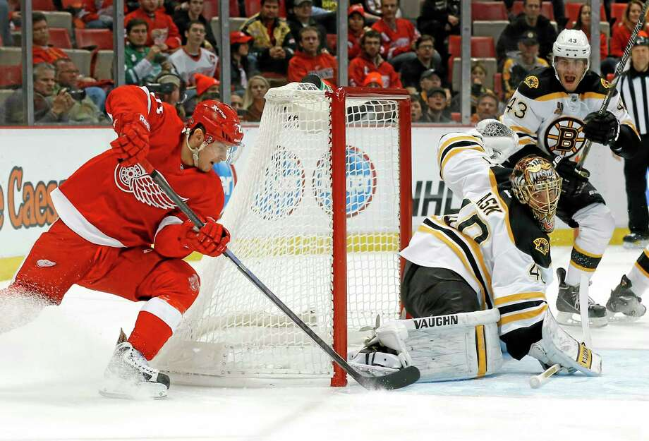 Red Wings left wing Tomas Tatar (21) scores against Boston Bruins goalie Tuukka Rask (40) in the second period of Wednesday's game in Detroit. Photo: Paul Sancya — The Associated Press   / AP