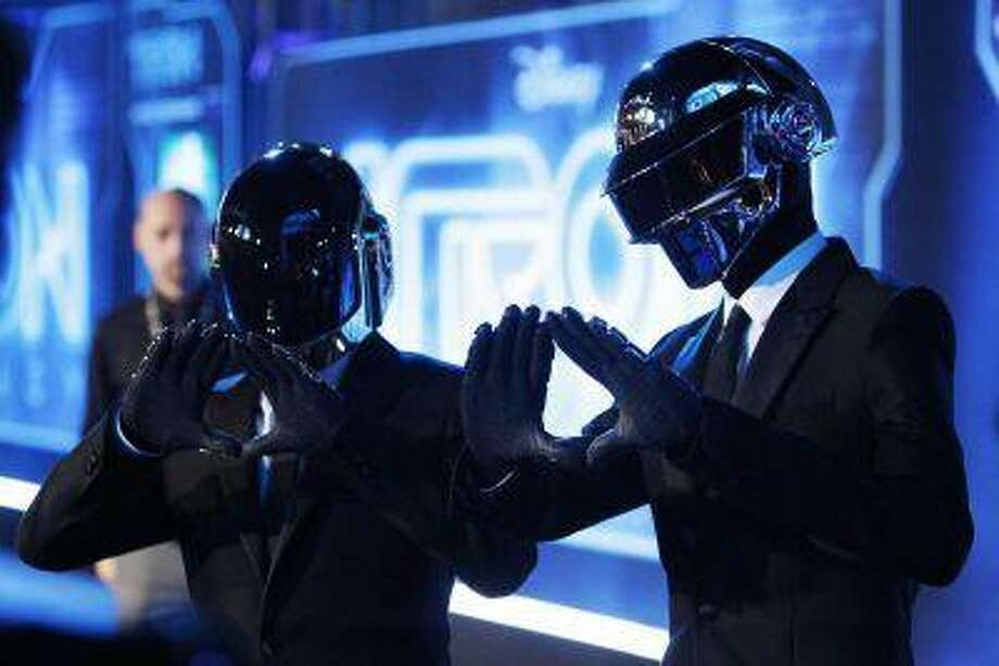 """Musicians Thomas Banglater and Guy-Manuel de Homem-Christo of Daft Punk pose at the world premiere of the film """"TRON: Legacy"""" in Hollywood, Calif., December 11, 2010. / X01907"""
