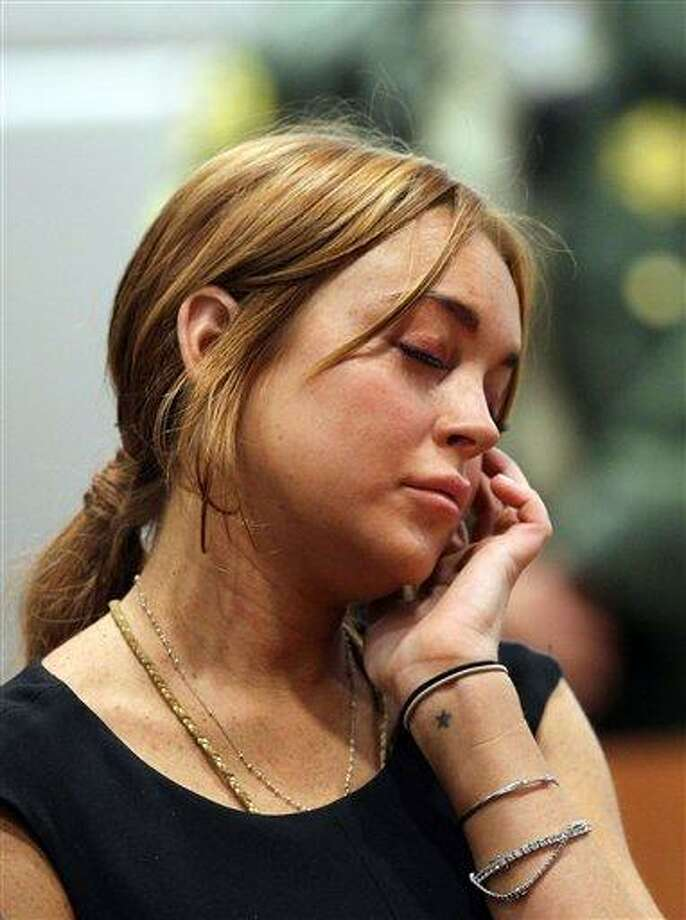 Actress Lindsay Lohan appears in Los Angeles court for a pretrial hearing, Wednesday, Jan. 30, 2013, in a case filed over the actress' June car crash. Lohan faces three misdemeanor charges and a return to jail if convicted in the case or if a judge finds she violated her probation. (AP Photo/David McNew, Pool) Photo: AP / Getty Images POOL