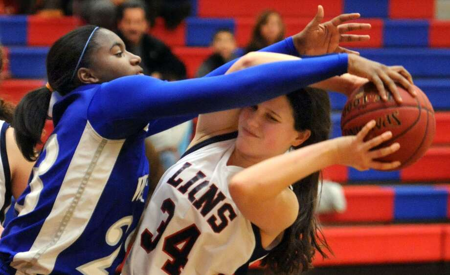 West Haven's Jayva Johnson ,left, shown here against Foran from earlier this month, scored 36 points in a win over Amity Wednesday. Mara Lavitt/New Haven Register.