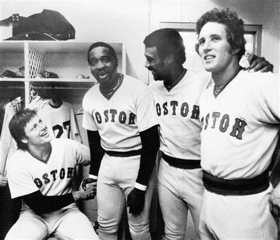 FILE - In this June 23, 1977 file photo, Boston Red Sox players from left Carlton Fisk, George Scott, Jim Rice and Butch Hobson gather in the locker room after a game with the Baltimore Orioles in Baltimore. Fisk hit two home runs and the others hit one each, setting a major league mark for most home runs in eight consecutive games with a total of 29. Scott died Monday, July 29, 2013 in his hometown of Greenville, Miss. He was 71. (AP Photo) Photo: AP / AP