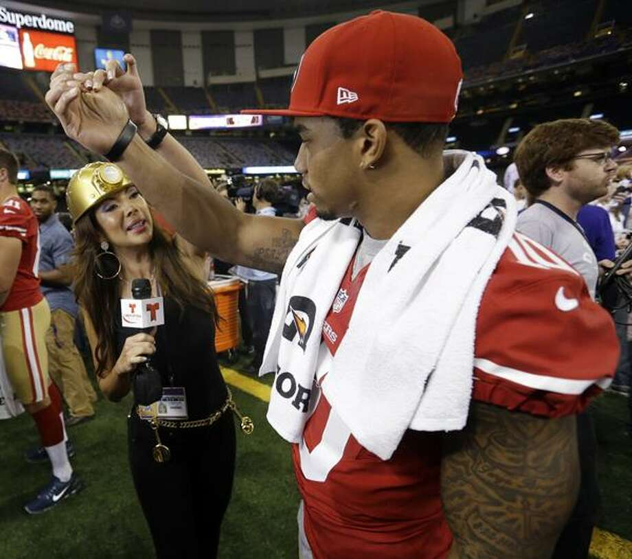 Telemundo's Mireya Grisales interviews San Francisco 49ers wide receiver Kyle Williams during media day for the NFL Super Bowl XLVII football game Tuesday, Jan. 29, 2013, in New Orleans. (AP Photo/Pat Semansky) Photo: AP / AP2013