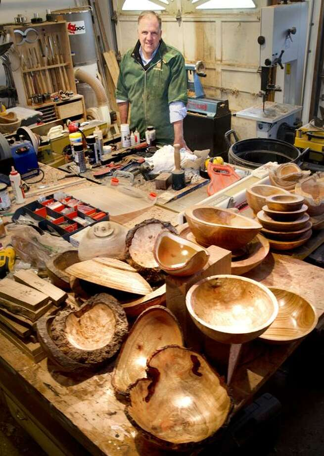HAMDEN--Scott Strobel, in his shop,  with some of his Yale Bowls.  Sctrobel is a professor at Yale University in the Departments of Molecular Biophysics & Biochemistry and Chemistry.  He makes the bowls from trees felled on Yale property.    Melanie Stengel/Register