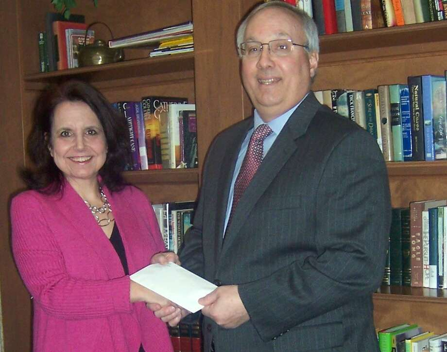 Submitted photo Laura Falt, left, director of Community Relations for Water's Edge, presents the check to Greg Kline, director of Institutional Advancement at Middlesex Community College.