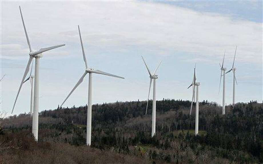 FILE - In this Oct. 26, 2011 file photo, wind turbines line the hillside at First Wind's project in Sheffield, Vt. Vermont U.S. Sen. Bernie Sanders is urging Vermont lawmakers not to put a three-year moratorium on the construction of new wind power projects in the state. Sanders says that if Vermont ceases new wind development, the message will out across the country that even in Vermont, there is not a serious commitment to combatting global warming.(AP Photo/Toby Talbot, File) Photo: AP / AP