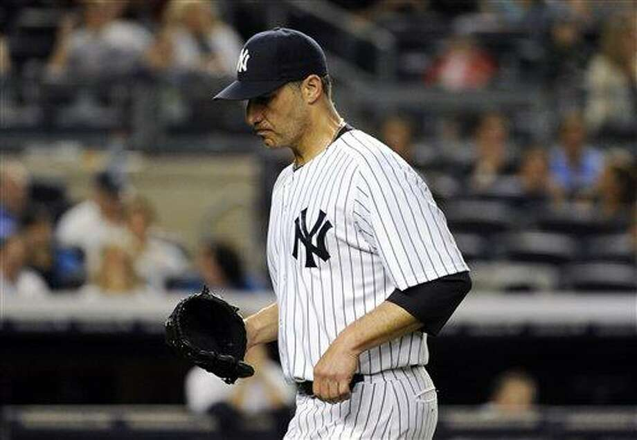 New York Yankees pitcher Andy Pettitte is taken out of the baseball game during the fifth inning against the Seattle Mariners Thursday, May 16, 2013, at Yankee Stadium in New York. (AP Photo/Bill Kostroun) Photo: AP / FR51951 AP