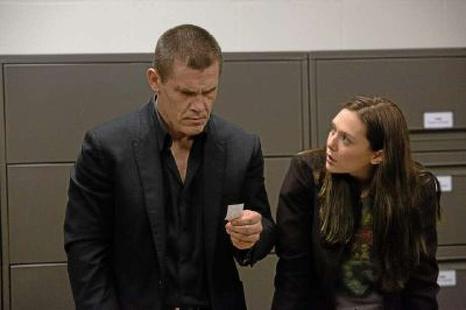 "Josh Brolin as Joe Doucett and Elizabeth Olsen as Marie Sebastian star in ""Oldboy."""