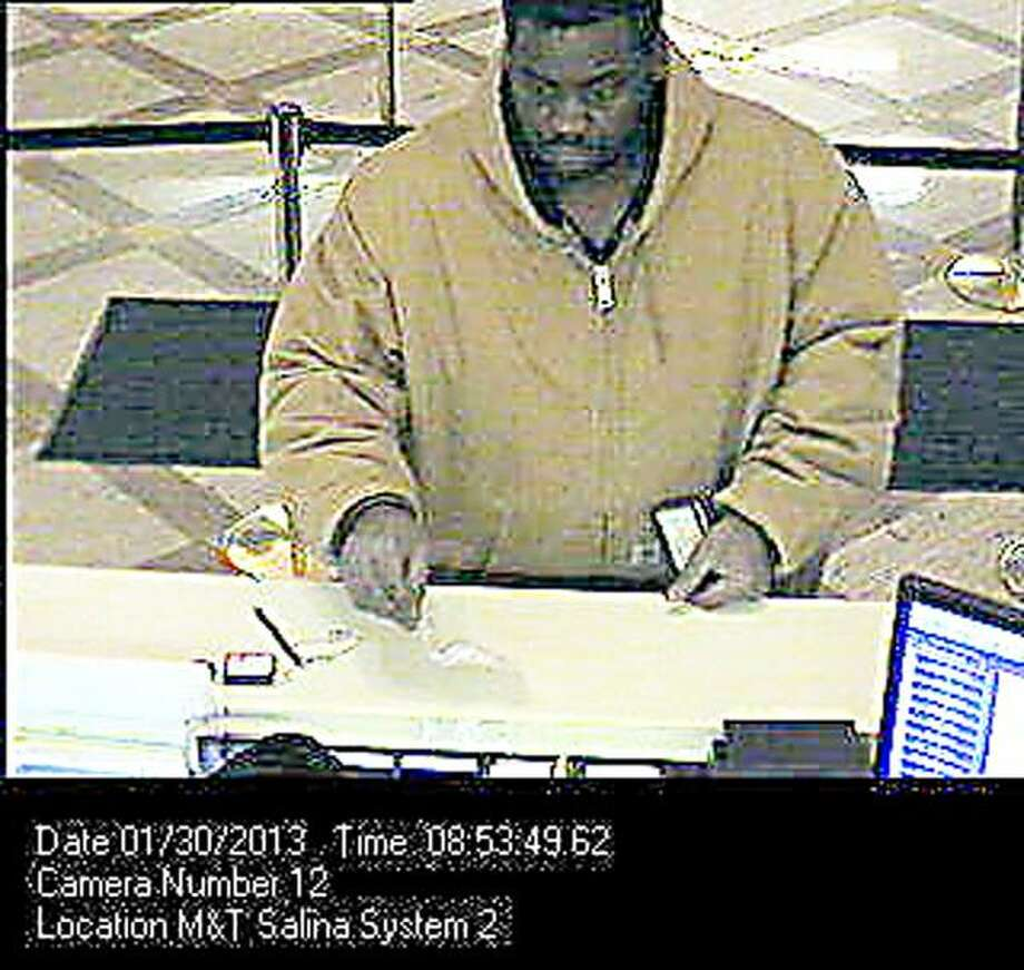 Photo Courtesy Syracuse Police Department This security still shows robbery suspect Leonard Stephens at the M&T Bank on South Salina Street in Syracuse.