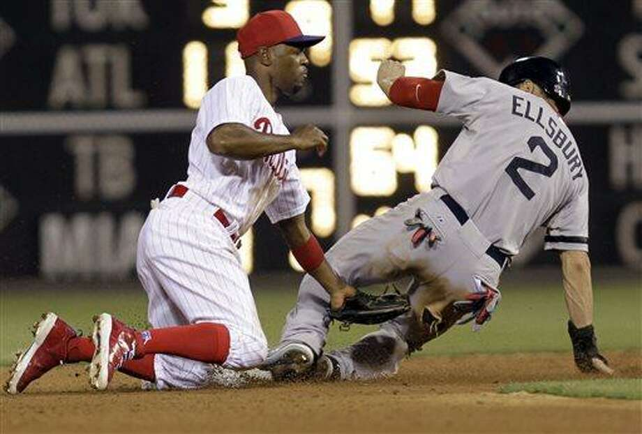 Boston Red Sox's Jacoby Ellsbury, right, steals second base past Philadelphia Phillies shortstop Jimmy Rollins in the eighth inning of an interleague baseball game, Thursday, May 30, 2013, in Philadelphia. (AP Photo/Laurence Kesterson) Photo: AP / FR170723 AP