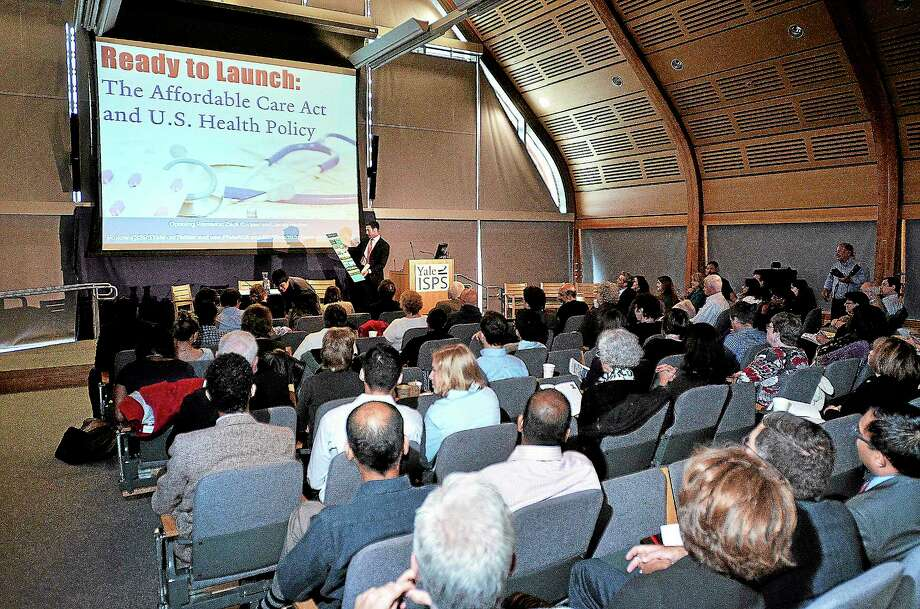 """The crowd listens during the """"Ready To Launch"""" conference discussing the Affordable Care Act and U.S. Health Policy. The event was held at Yale's Kroon Hall. Photo: Peter Casolino — New Haven Register"""